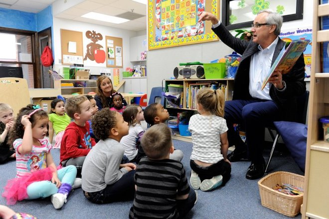 Ron Romain reads to children at St. Vincent